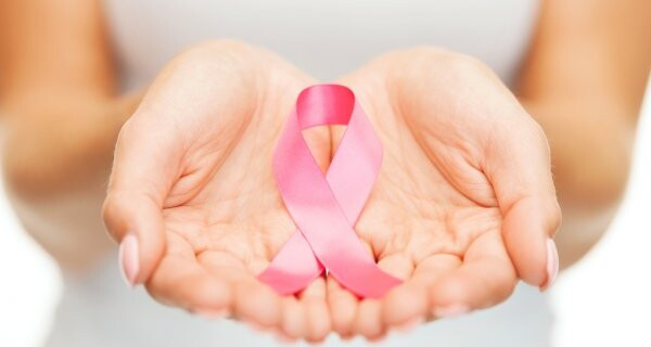 depositphotos_35349215-stock-photo-hands-holding-pink-breast-cancer