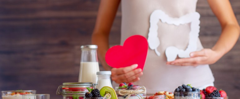 Female,Is,Holding,Figures,Of,Heart,And,Intestines.,Summer,Breakfast